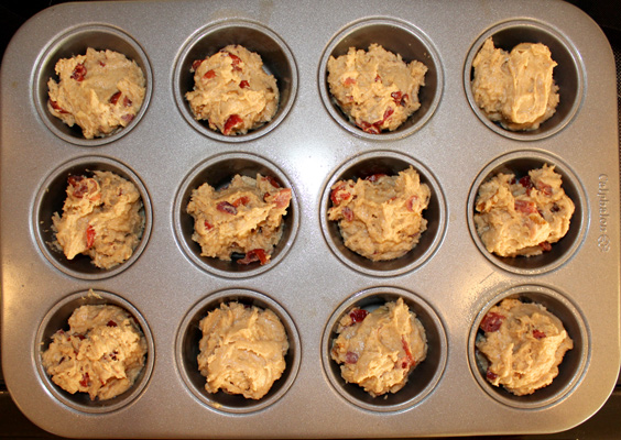 Divide batter evenly in muffin tin.