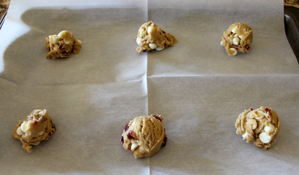 Use a small scoop to place rounded balls of dough on cookie sheet.