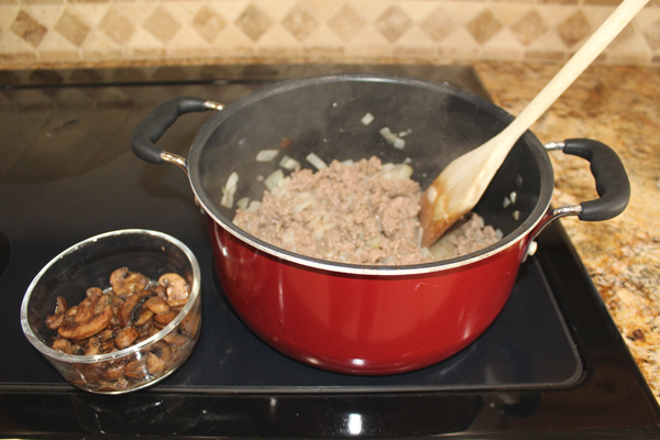 Brown ground beef with onions