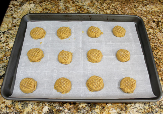 Make a criss-cross shape with a fork to flatten the top of the cookie