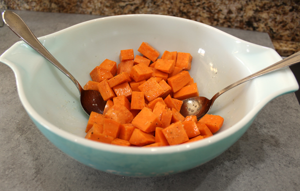 Toss sweet potatoes with coconut oil, salt and pepper