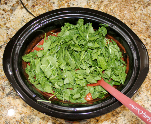 Add the chopped spinach to the slow cooker