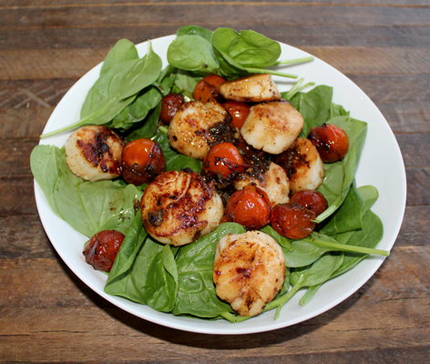 Pan seared scallops over spinach